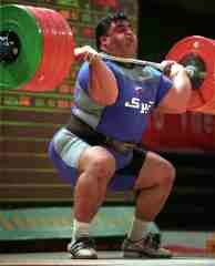 Hossein Rezazadeh racking 250 kg at the 2003 Asian Weightlifting Championships (Quinhuangdao, China). IronMind® | Randall J. Strossen, Ph.D. photo.