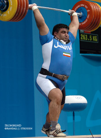 He won the gold medal with his first clean and jerk (250 kg) in Athens, but on his third attempt, Hossein Rezazadeh punched up this 263.5 kg clean and jerk for a new world record. IronMind® | Randall J. Strossen, Ph.D. photo.