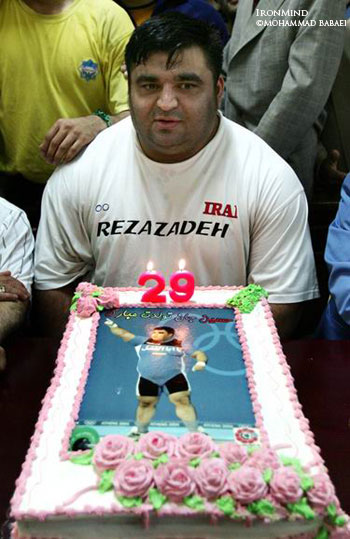 Hossein Rezazadeh sits down to his birthday cake, celebrating his 29th birthday in Tehran. IronMind® | Mohammad Babaei photo.