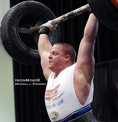 Ryan Bakke hit this world record 185-kg lift on the Apollon's Axle at the FitExpo earlier this year. As formidable as it is, Bakke's world record is expected to be under serious attack at the Mohegan Sun this coming weekend when Giants Live brings in some of the world's premier strongmen, ready to lock horns with this classic test of strength. IronMind® | Randall J. Strossen photo.