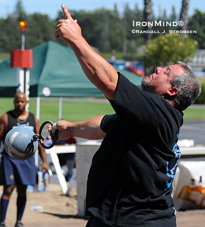 Ryan Vierra on the 56-lb. weight for height at the 2009 Pleasanton Highland Games.  IronMind® | Randall J. Strossen photo.