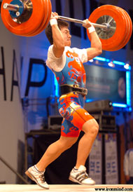 Sa Jae-Hyuk drives himself under the 179-kg jerk that gave him the gold medals in the both the clean and jerk, and the total. IronMind® | Randall J. Strossen, Ph.D. photo.