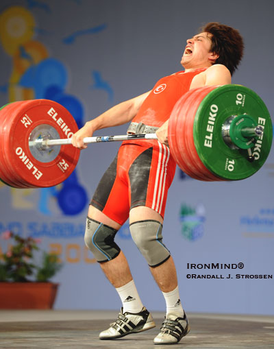 Turkey's Taner Sagir, the defending 77-kg Olympic weightlifting champion, shown attempting a 197-kg clean and jerk at the 2008 Europeans Weightlifting Championships, gives you an idea of what the sport of weightlifting is about: pulling hard and moving fast are just the beginning. IronMind® | Randall J. Strossen photo.