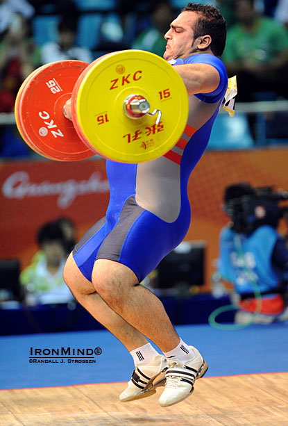 Behdad Salimi (Iran), shown in midflight with his 205-kg snatch at the 2010 Asian Games, won the supers at the recent Asian Weightlifting Championships via a 208-kg snatch and a 250-kg clean and jerk.  IronMind® | Randall J. Strossen.