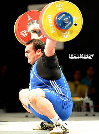 Behdad Salimi had recently snatched 217 kg in a small contest, so everyone knew the horsepower and the technique were there to break Hossein Rezazadeh's longstanding world record in the snatch.  Salimi showed that his unofficial performances were no fluke as he sank the putt on this 214-kg snatch at the World Weightlifting Championshps, good for a new world record.  IronMind® | Randall J. Strossen photo.