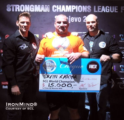Ervin Katona (center) won the 2011 Strongman Champions League World Championships and received the US$15,000 Monster Milk–SCL check from SCL cofounders Marcel Mostert (left) and Ilkka Kinnunen (right).  IronMind® | Courtesy of  SCL.