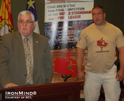 St. John, New Brunswick mayor Ivan Court (left) introduces the SCL–Canada strongman competition with backup provided by top Canadian strongman Christian Savoie (right).  IronMind® | Courtesy of SCL.