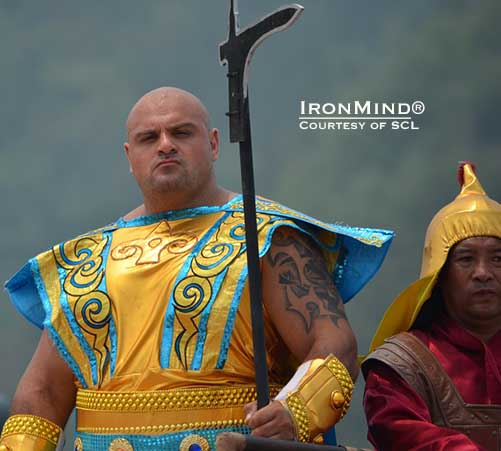 Laurence Shahlaei, in gladatorial splendor, sets the tone for SCL–China.  Shahlaei was captain of the Blue Team, in a format unlike anything seen before in strongman in a contest of unrivaled scale and staging.  IronMind® | Courtesy of SCL.
