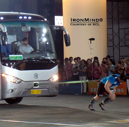 Using just an IronMind pulling harness and no rope, Jarno Hams broke the Guinness world record in the bus pull in Beijing.  IronMind® | Courtesy of SCL.