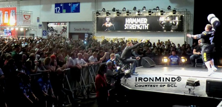 "The Big Z (Zydrunas Savickas) on stage before a packed house at the FIBO Power, where the SCL Germany contest took place.  ""The Strongman Champions League is getting an incrediblly strong value at the FIBO,"" said Marcel Mostert.  IronMind® 