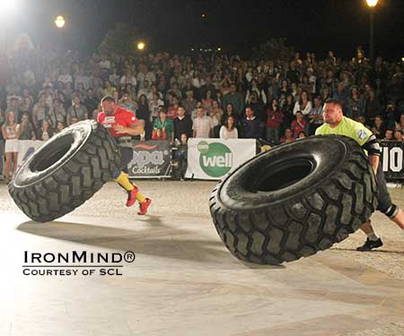 Terry Hollands (left) going head-to-head with Krzysztof Radzikowski (right) in the tire flip at SCL Portugal.  IronMind® | Photo courtesy of SCL