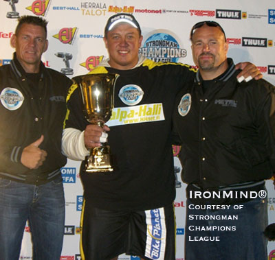 Misha Koklyaev (center) won the Strongman Champions League 2009 season opener in Serbia. SCL cofounders Marcel Mostert (left) and Ilkka Kinnunen (right) flank the man who many see as a favorite to break the world record in the Apollon's Axle™ at the Giants Live Mohegan Sun contest next weekend and possibly go on to become the first Russian to win the World's Strongest Man contest later this year. IronMind® | Photo courtesy of Strongman Champions League.