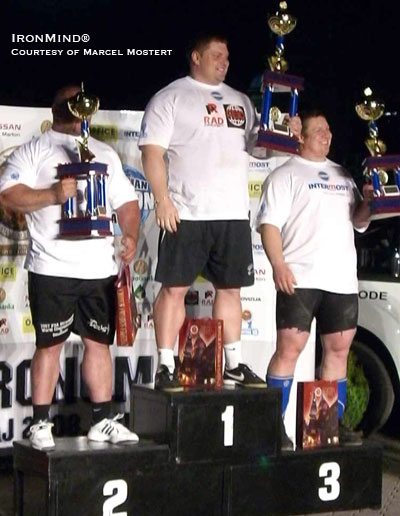 Here's the podium at the Strongman Champions League contest in Serbia (left to right): Ervin Katona (second), Zydrunas Savickas (first), Andrus Murumets (third). IronMind® | Photo courtesy of Marcel Mostert.