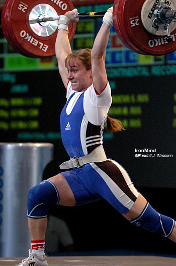 Marina Shainova (Russia) nails this 130-kg clean and jerk, sweeping the gold medals in the women's 58-kg category at the European Weightlifting Championships today. IronMind® | Randall J. Strossen, Ph.D. photo.