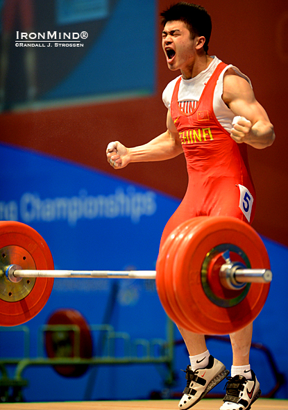 Shi Zhiyong (China) celebrates the go-ahead 180-kg clean and jerk that ended up giving him the gold medal for the jerk as well as for the total in the 69-kg class at the Asian Weightlifting Championships today.  IronMind® | Randall J. Strossen photo.