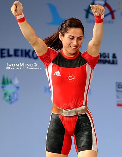 Turkish weightlifting star Sibel Simsek quietly celebrates a good lift at the 2008 European Weightlifting Championships (Lignano-Sabbiadoro, Italy).  Lifting in the women's 63-kg category, Simsek snatched 105 kg, and cleaned and jerked 121 kg.  IronMind® | Randall J. Strossen photo.