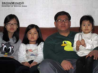 """Look at what my dad can do?""  Sun-gil Gwon's daughter holds up the IronMind Red nail that her father officially bent.  IronMind® 
