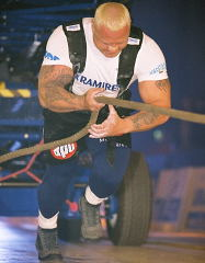 Svend Karlsen working on the Apollon's Axle at the 2003 Beautry & the Beast Super Series strongman contest. IronMind® | Randall J. Strossen, Ph.D. photo.