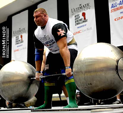 Terry Hollands pulls an easy 1025-lb. deadlift on the giant globe barbell at the LA FitExpo strongman contest.  IronMind® | Randall J. Strossen photo.