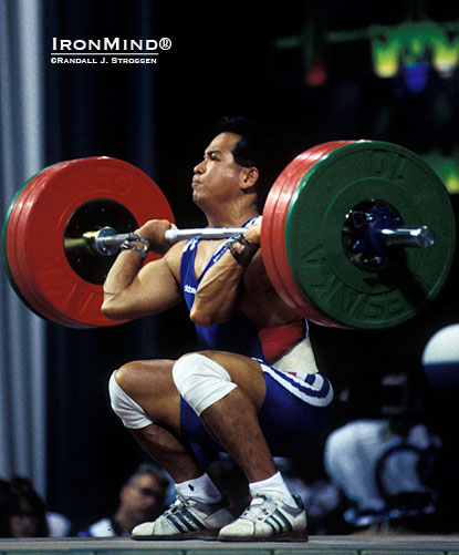 Just because Thanh Nguyen roller skated into The Sports Palace and ended up making an Olympic weightlifting team, don't think he lived on Easy Street.  This shot is of Thanh cleaning 145 kg in the 64-kg class at the 1996 Olympics.  IronMind® | Randall J. Strossen photo.