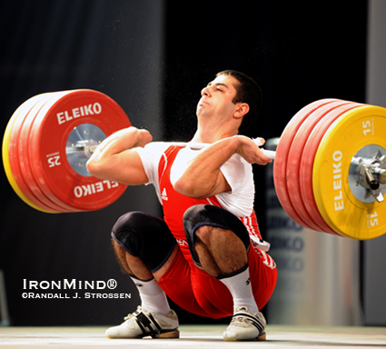 Chalk flying, the bar bending, Tigran Martirosyan hits the bottom with 205 kg.  Martirosyan cleaned the weight, but missed the jerk.  IronMind® | Randall J. Strossen photo.