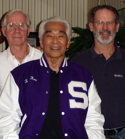 Tommy Kono (center) sports the Sacramento High letter jacket given to him at a 2006 dinner in his honor.  That's Don Wilson (left) and Jim Schmitz (right) . . . three good reasons why the Pacific Weightlifting Association has the mighty legacy that it does.  IronMind® | Randall J. Strossen photo.