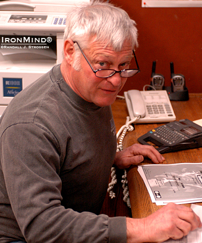 Inspired weightlifting coach Tom Hirtz takes care of some paperwork right before the 2007 IronWorks Open (Springfield, Oregon).  IronMind® | Randall J. Strossen photo.