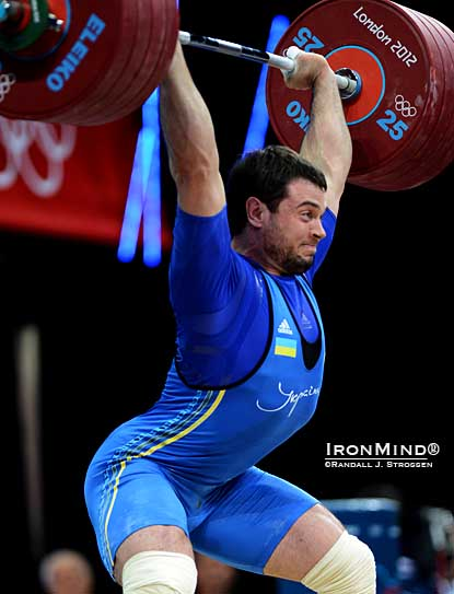 The door was opened for Oleksiy Torokhtiy (Ukraine) in the 105s and he walked in and seized the gold medal, clinching the deal with this third attempt 227-kg power jerk.  IronMind® | ©Randall J. Strossen photo.