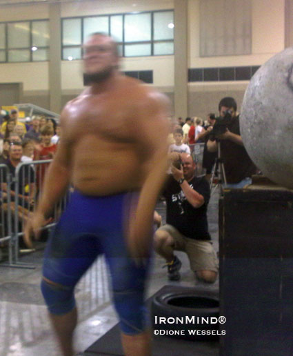 He's a blur, but that's Travis Ortmayer after loading five stones in what might be the fastest time ever for  a comparable series of strongman stones.  IronMind® | Dione Wessels photo.