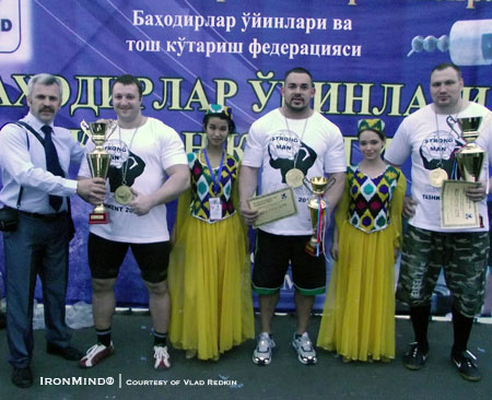 (left to right) Vlad Redkin presents the second place trophy to Alex Lapirev (Belatus).  Kevin Nee (USA) was third and Tarmo Mitt (Estonia) won the first stage of the Asia World Cup strongman series in Uzbekistan.  IronMind® | Courtesy of Vlad Redkin.