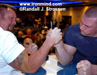 They might not be nuclear, but the arms sported by Rick Vardell (left) and Robbie Topie (right) at Boomtown last night could pump up the arsenals of a lot of smaller countries. IronMind® | Randall J. Strossen photo.