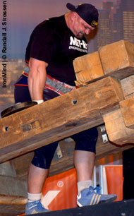 Vasyl Virastyuk (Ukraine) fighting his way up the ramp on the MET-Rx Timber Carry at the 2006 Arnold Strongman contest. IronMind® | Randall J. Strossen, Ph.D. photo.