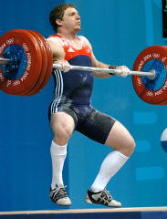 Chad Vaughn pulls himself under his 175-kg opening clean and jerk at the 2004 Olympics. IronMind® | Randall J. Strossen, Ph.D. photo.