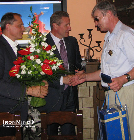 Vladimir Kiba (right) turned 60 last week and the famed pole vaulter and president of the Ukrainian Olympic Committee Sergey Bubka (center) was among the guests enjoying themselves and honoring Kiba.  On the left is Oleksandr Yakovlev (former triple jumper), another fried of the Kibas and the head of finance for the Ukrainian Olympic Committee. IronMind® | Photo courtesy of Olena Kiba.