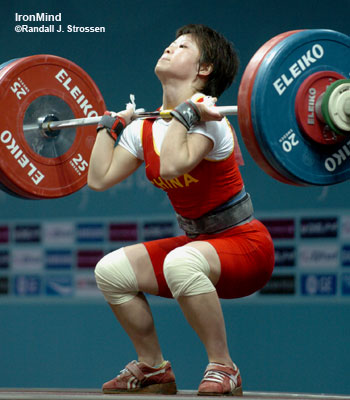 Wang Mingjuan got under 118 kg, equal to her junior world record in the clean and jerk, but she could not stand up with it. IronMind® | Randall J. Strossen, Ph.D. photo.