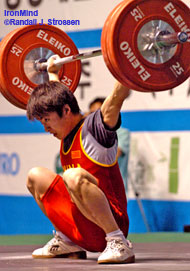 Low and solid, this 125-kg snatch gave Wang Wenquing the margin he needed to win the 62-kg category at the Asian Junior Weightlifting Championships today. IronMind® | Randall J. Strossen, Ph.D. photo.
