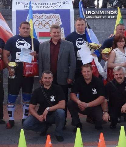 Leonid Taranenko (center) did the honors of opening the WSF–World Cup strongman contest in Minsk.  Taranenko's mighty credits as a weightlifter include an Olympic gold medal and the highest official clean and jerk in history.  Taranenko is now the executive director of the Belarus National Olympic Committee office in Minsk, Redkin told IronMind.  IronMind® | Courtesy of WSF–World Cup.