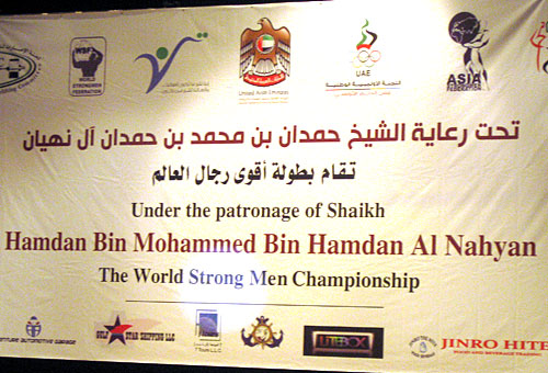Unlike the report that this contest being misrepresented as being World's Strongest Man, the banner at the opening ceremony clearly displays what organizer Vlad Redkin says is the contest's  actual, official name: WSF World Strongmen Championship 2012 in Abu Dhabi under the patronage of His Highness Sheikh Hamdan Bin Mahammed Bin Hamdan Al Nahyan.  IronMind® | Courtesy of WSF.