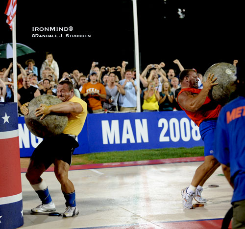 Mariusz Pudzianowski (left) is closing in on the final stone at the 2008 MET-Rx World's Strongest Man contest. Derek Poundstone (right) was on his way up with his stone a tick or two ahead of Mariusz, but he didn't quite get the stone placed and it came crashing back down. This should make for terrific television - watch for the 2008 WSM broadcast schedule. IronMind® | Randall J. Strossen, Ph.D. photo.