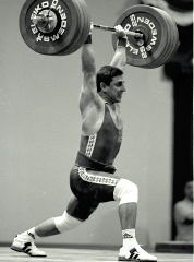 Yoto Yotov sticks this 202.5-kg jerk to win the 76-kg category at the 1997 World Weightlifting Championships (Chiang Mai, Thailand). IronMind® | Randall J. Strossen, Ph.D. photo.