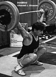 Here is Yoto Yotov as a young lifter, shown in the training hall at the 1990 Goodwill Games. Lifting for the powerhouse Bulgarian weightlifting team, Yotov was a silver medalist at the 1992 and the 1996 Olympics, and he collected piles of medals in European and World Weightlifting Championships. Yotov won the 76-kg class at the 1997 Worlds, where he snatched 165 kg and cleaned and jerked 202.5 kg. IronMind® | Randall J. Strossen, Ph.D. photo.