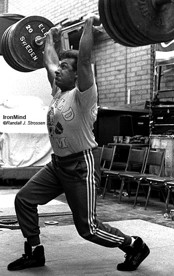 Yurik Vardanian, who totaled a staggering 400 kg as an 82.5-kg weightlifter at the 1980 Olympics, couldn't keep his hands off the bar 15 years later in Fresno - this was in the warmup room at the 1995 USA Weightlifting National Championships, where, just playing around, Vardanian cleaned and jerked 150 kg. IronMind® | Randall J. Strossen, Ph.D. photo.