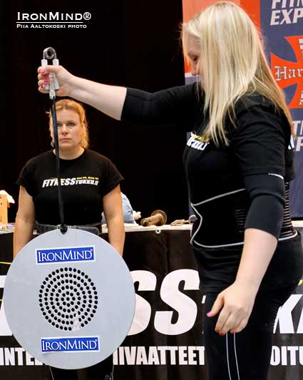 With Jaana Tanner cheering her on, Yvonne Häkkinen hit a very impressive 18.00 seconds on the CoC Silver Bullet Hold (using a Captains of Crush No. 2 gripper) at last weekend's IronMind Grip Class Semi-Finals (held at the Finnish Fitness Expo).  IronMind® | Photo by Piia Aaltokoski, courtesy of United Strongmen®.