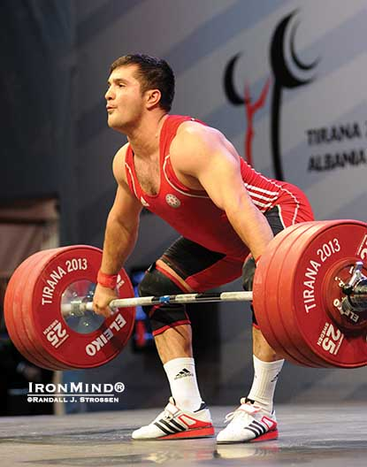 With this 180-kg snatch, Intigam Zairov (Azerbaijan) pocketed the first of his three gold medals in the 94-kg category at the 2013 European Weightlifting Championships in Tirana, Albania.  IronMind® | Randall J. Strossen photo