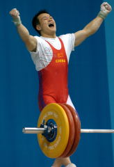 """Yes!"" On his way to Olympic gold in Athens, 69-kg weightlifter Zhang Guozheng (China) celebrates his successful 157.5-kg snatch at the 2004 Olympics. Zhang Guozheng and his teammate Shi Zhiyong will be lifting on the main Expo stage at the Arnold this Saturday at approximately 2:00 p.m. IronMind® 