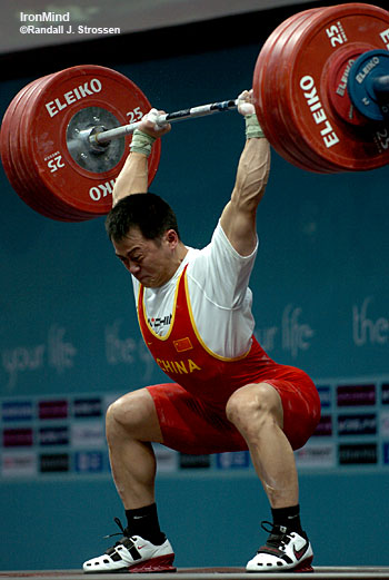 Zhang Guozheng squat jerks 184 kg to win the gold medal in the 69-kg category at the Asian Games today. IronMind® | Randall J. Strossen, Ph.D. photo.