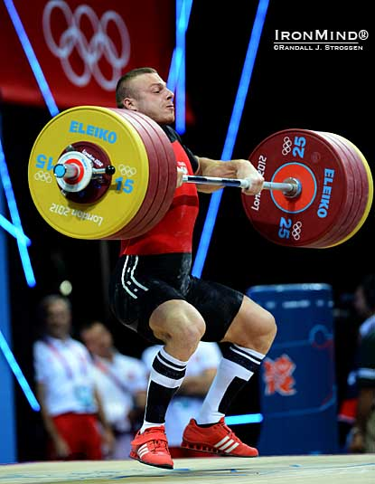 Adrian Zielinski (Poland) pulls himself under 211 kg in what proved to be the winning clean and jerk in the men's 85-kg class at the Olympics tonight.  IronMind® | Randall J. Strossen photo.