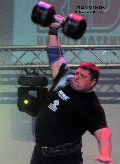 Zydrunas Savickas bangs out 11 reps to win the dumbbell press at the Ultimate Strongman Championships.  IronMind® | Photo courtesy of Heather Kliese.