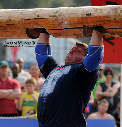 Proving once again that he is the king of the overhead lifts in strongman, Zydrunas Savickas broke the world record in the log with this 210-kg lift today at the 2010 MET-Rx World's Strongest Man contest.  IronMind® | Randall J. Strossen photo.