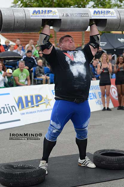 Zydrunas Savickas opened his 2012 strongman season with a world record attempt in the Log Lift at the MHP Strongman Champions League–Holland and you can see how close he came to succeeding with the 221-kg lift.  IronMind® | Randall J. Strossen photo.